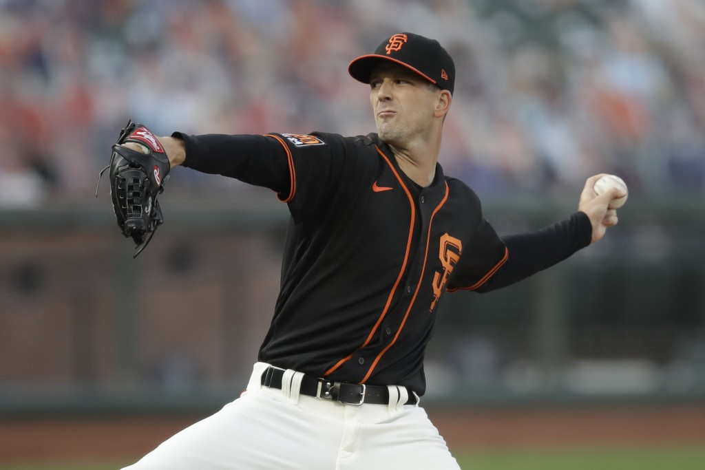 San Francisco Giants pitcher Drew Smyly works against the Texas Rangers during the first inning of a baseball game Saturday, Aug. 1, 2020, in San Fran...