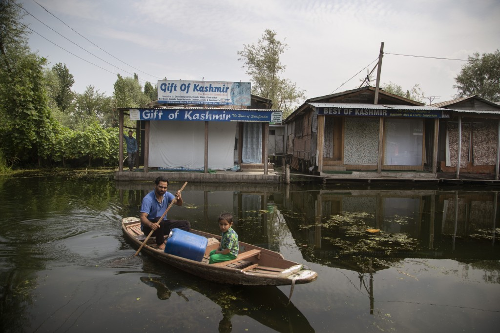A Kashmiri boatman rows his boat through a closed floating market on the Dal Lake during lockdown to stop the spread of the coronavirus in Srinagar, I...