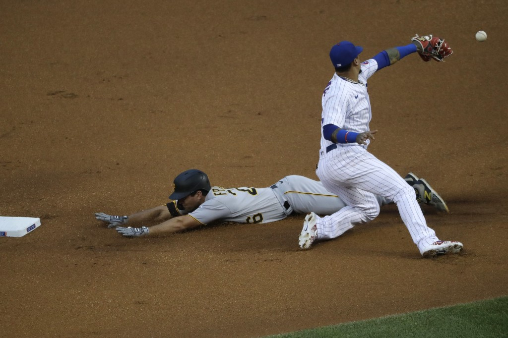 Pittsburgh Pirates' Adam Frazier, left, is safe at second after hitting a double as Chicago Cubs shortstop Javier Baez misses the catch during the fir...
