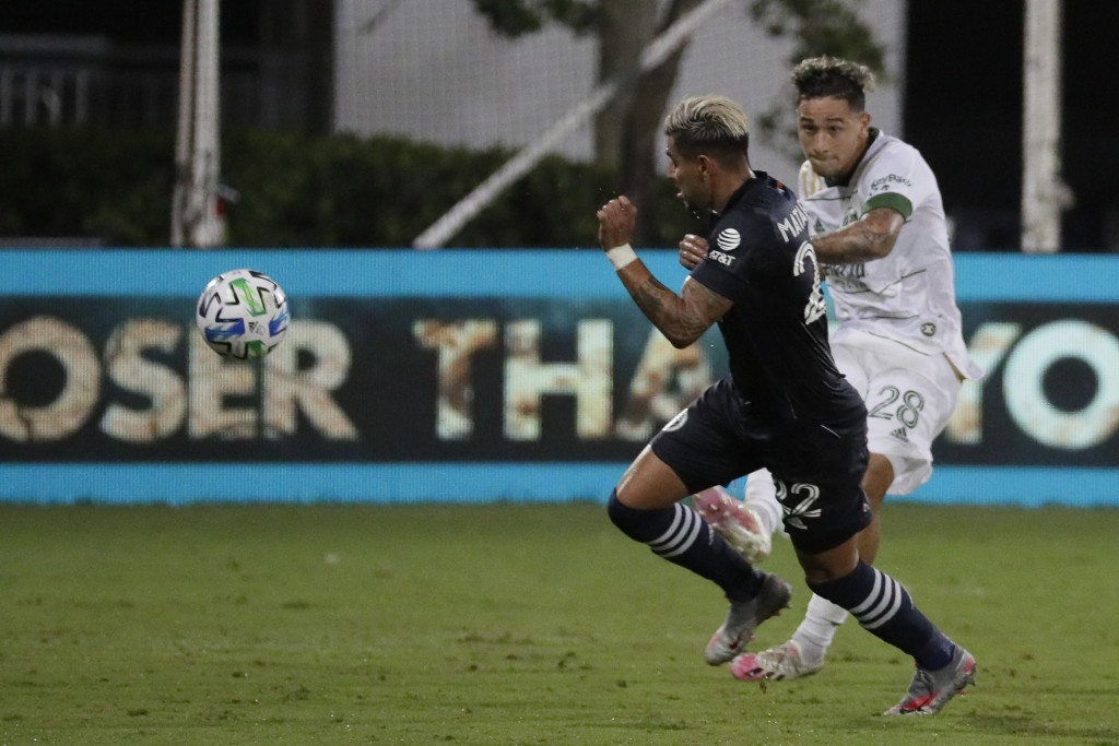 New York City defender Ronald Matarrita, left, moves the ball past Portland Timbers'Pablo Bonilla, during the first half of an MLS soccer match, Satur...