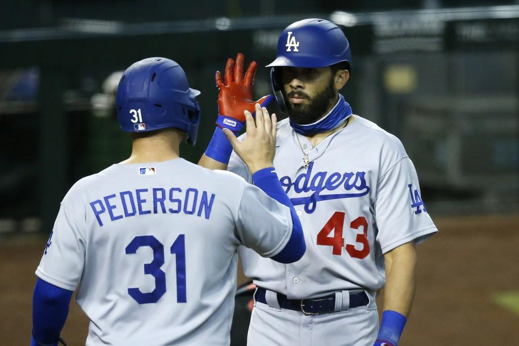 Los Angeles Dodgers' Edwin Rios (43) celebrates his two-run home run against the Arizona Diamondbacks with Joc Pederson (31) during the fourth inning ...