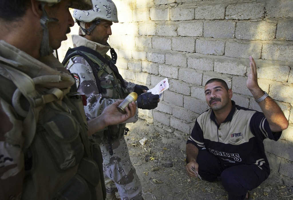 FILE—This file photo from Aug. 6, 2005 shows Iraqi soldiers working with Lima Company of the U.S. Marines 3rd Battalion, 25th Regimen from Ohio, quest...