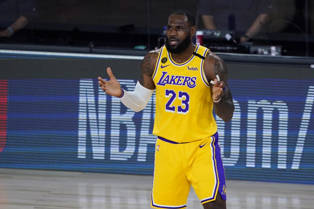 Los Angeles Lakers' LeBron James (23) reacts after a play against the Toronto Raptors during the first half of an NBA basketball game Saturday, Aug. 1...