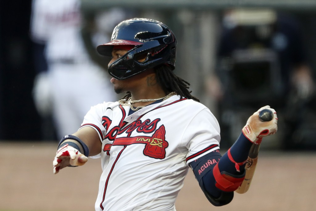 Atlanta Braves' Ronald Acuña Jr. follows through on an RBI double during the second inning of the team's baseball game against the New York Mets on Sa...