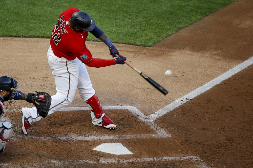 Minnesota Twins' Miguel Sano hits a solo home run against the Cleveland Indians during the fifth inning of a baseball game Saturday, Aug. 1, 2020, in ...