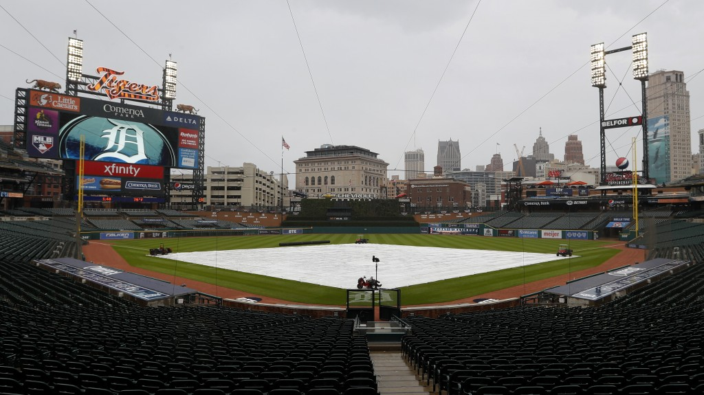 Rain falls on Comerica Park during a weather delay for a baseball game between the Cincinnati Reds and Detroit Tigers in Detroit, Saturday, Aug. 1, 20...
