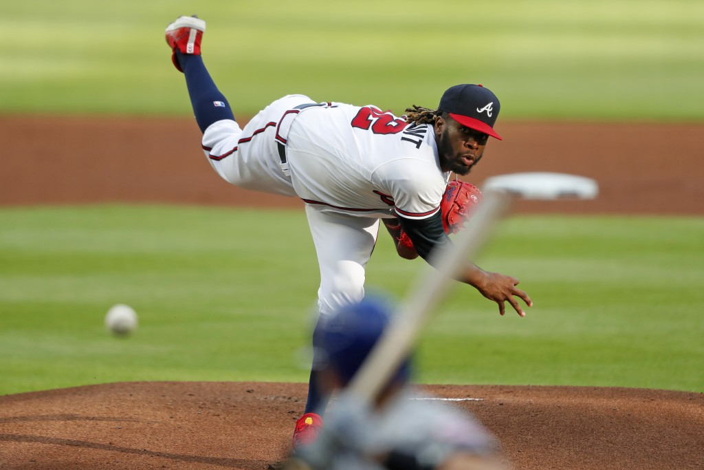 Atlanta Braves relief pitcher Touki Toussaint, top, delivers to New York Mets' Jeff McNeil in the first inning of a baseball game Saturday, Aug. 1, 20...