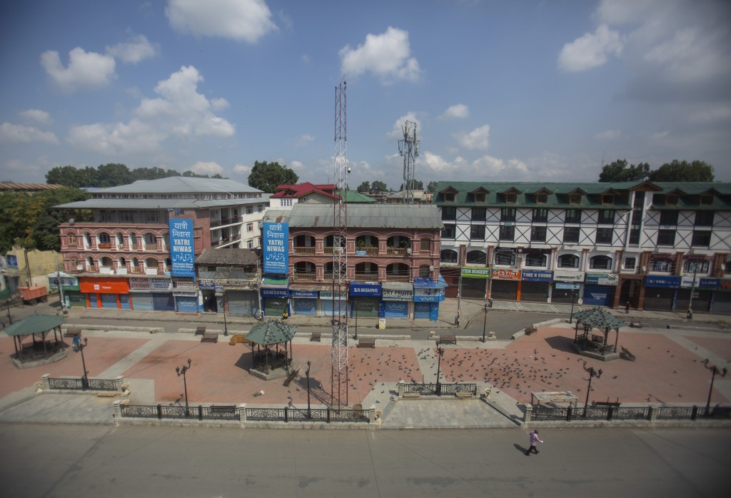 A man walks at a deserted market area during lockdown to stop the spread of the coronavirus in Srinagar, Indian controlled Kashmir,  July 22, 2020. In...