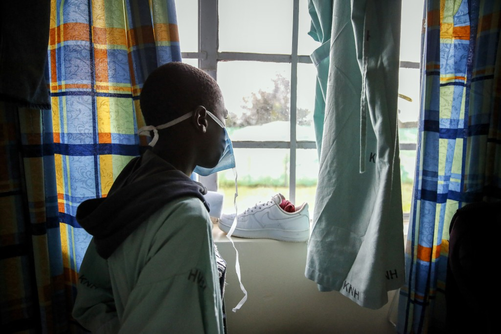 FILE - In this May 1, 2020, file photo, a patient looks out of the window in a ward for those who have tested positive for the new coronavirus, at the...