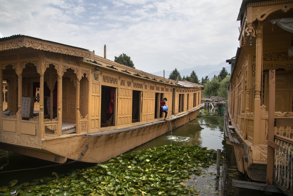 Kashmiri man Illiyas Ahamad cleans an unoccupied houseboat at Nigeen Lake during lockdown to stop the spread of the coronavirus in Srinagar, Indian co...