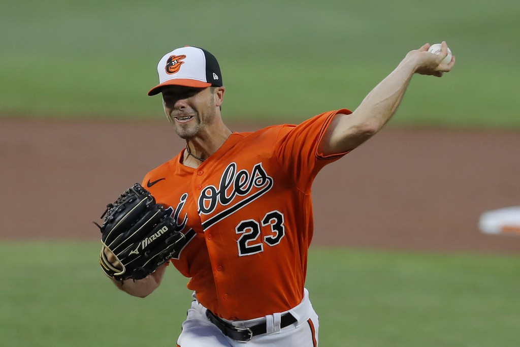 Baltimore Orioles starting pitcher Wade LeBlanc throws a pitch to the Tampa Bay Rays during the first inning of a baseball game, Saturday, Aug. 1, 202...