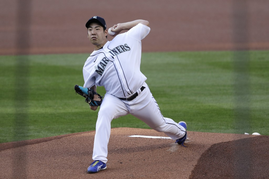 Seattle Mariners starting pitcher Yusei Kikuchi throws to an Oakland Athletics batter during the first inning of a baseball game Saturday, Aug. 1, 202...