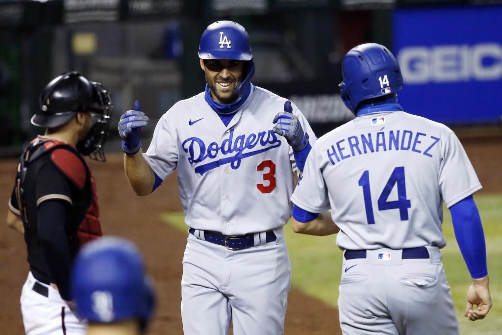 Los Angeles Dodgers' Chris Taylor (3) smiles as he celebrates his three-run home run against the Arizona Diamondbacks with teammate Kiké Hernandez (14...