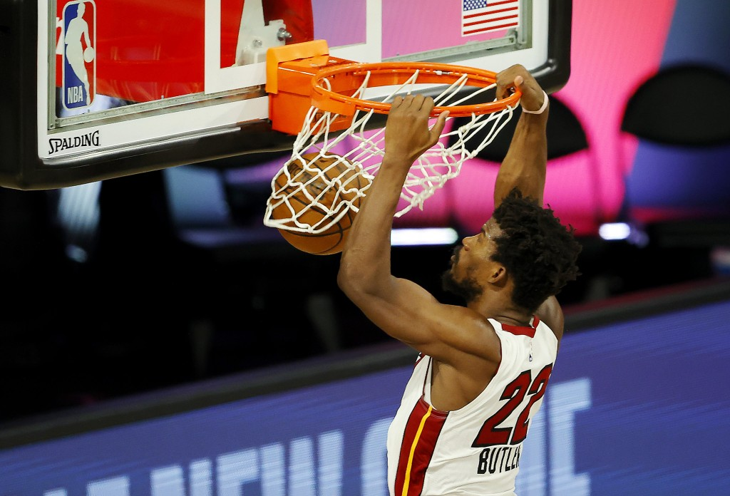 Miami Heat's  Jimmy Butler dunks against the Denver Nuggets during an NBA basketball game, Saturday, Aug. 1, 2020, in Lake Buena Vista, Fla. (Kevin C....