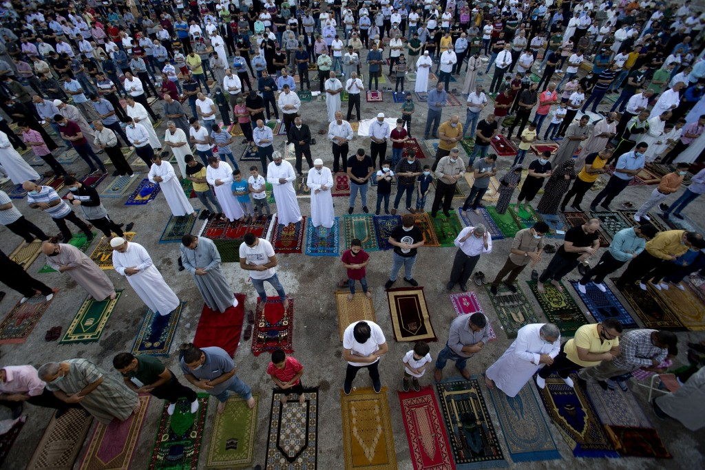 Palestinians Muslims offer Eid al-Adha prayers, in the West Bank city of Nablus, Friday, July 31, 2020. Muslims worldwide marked the the Eid al-Adha h...