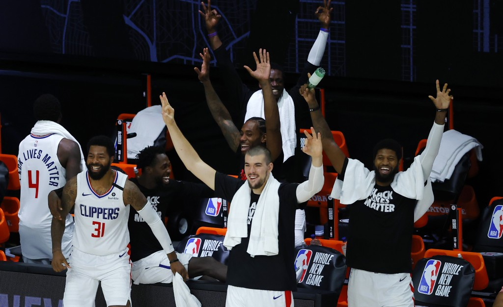 Members of the Los Angeles Clippers celebrate after breaking a team three-point record during an NBA basketball game against the New Orleans Pelicans,...