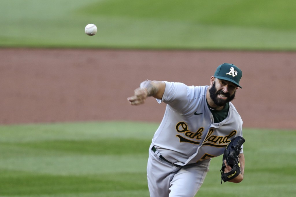 Oakland Athletics starting pitcher Mike Fiers throws to a Seattle Mariners batter during the first inning of a baseball game Saturday, Aug. 1, 2020, i...