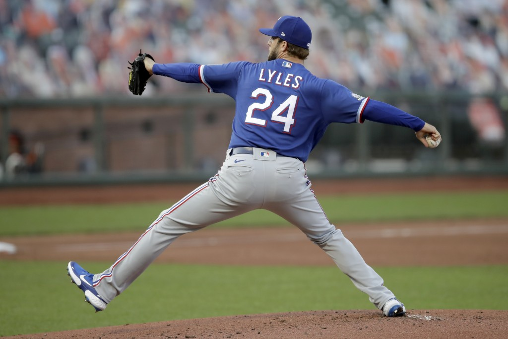 Texas Rangers pitcher Jordan Lyles works against the San Francisco Giants during the first inning of a baseball game Saturday, Aug. 1, 2020, in San Fr...