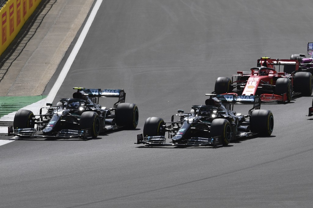 Mercedes driver Valtteri Bottas of Finland, left and Mercedes driver Lewis Hamilton of Britain steer their cars during the British Formula One Grand P...