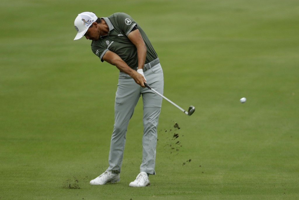 Rickie Fowler hits form the fairway on the 18th hole during the third round of the World Golf Championship-FedEx St. Jude Invitational Saturday, Aug. ...
