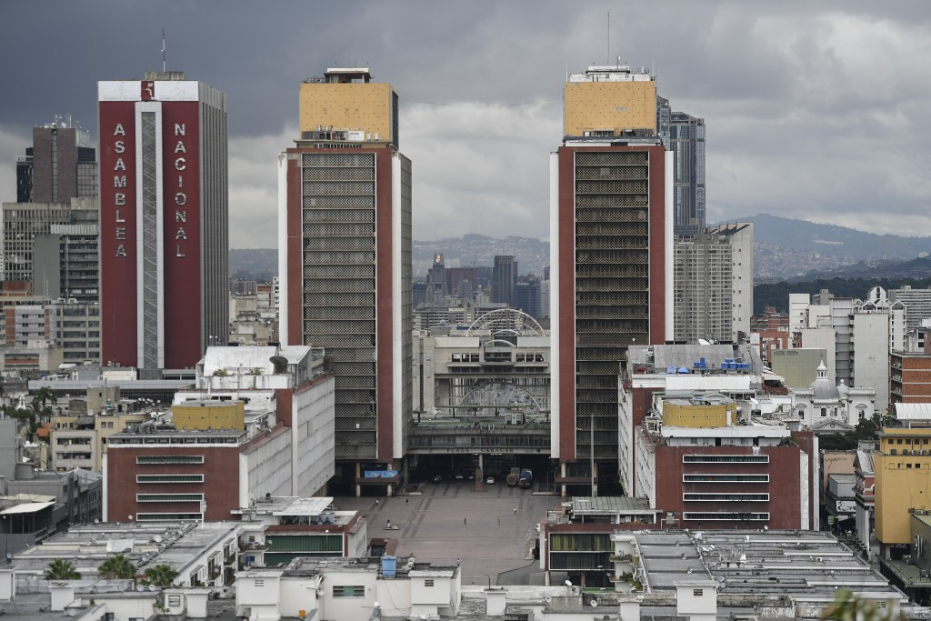 A view of an almost empty Plaza Caracas, and the National Assembly building in Caracas, Venezuela, Saturday, Aug. 1, 2020, amid the new coronavirus pa...