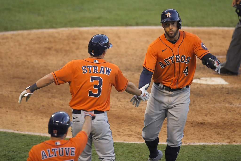 Houston Astros' George Springer, right, is congratulated by Myles Straw, center, and Jose Altuve after hitting a two-run home run during the ninth inn...