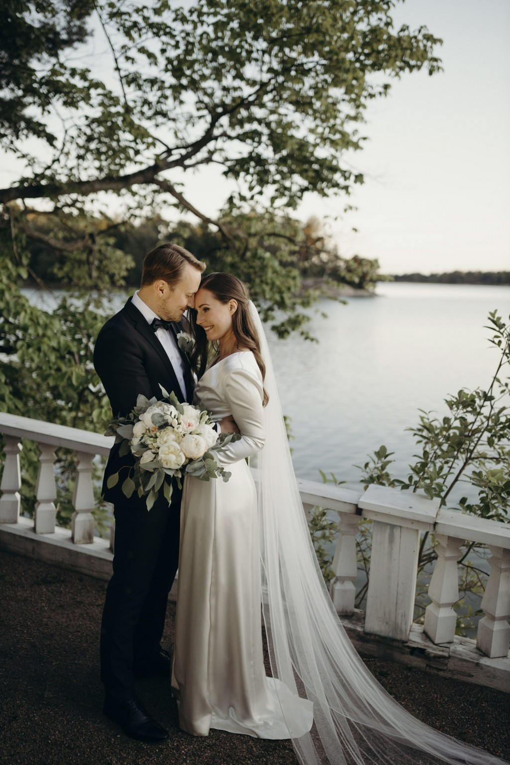 In this handout photo provided by the Finnish Prime Minister's Office on Sunday, Aug. 2, 2020, Finnish Prime Minister Sanna Marin and her new husband ...