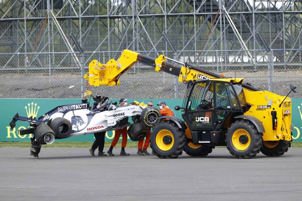 Alpha Tauri car of Daniil Kvyat of Russia is carried off track after crashing during the British Formula One Grand Prix at the Silverstone racetrack, ...
