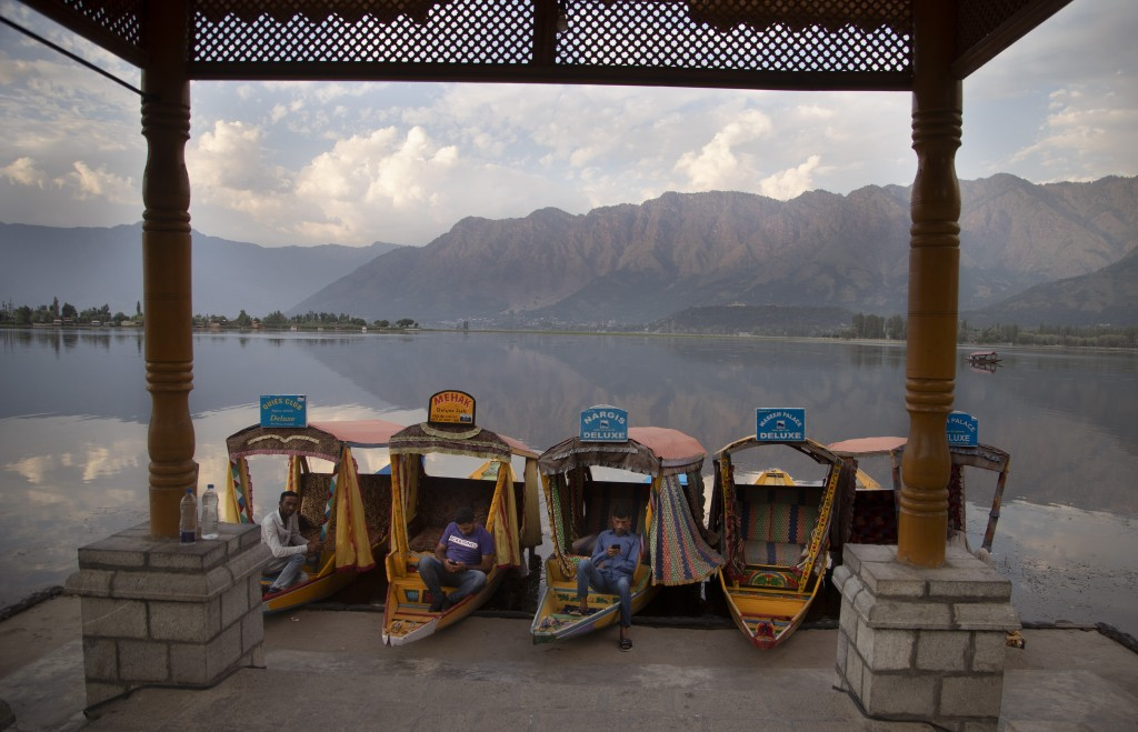 Kashmiri boatmen rest as they wait for customers on the deserted banks of the Dal Lake in Srinagar, Indian controlled Kashmir, July 20, 2020. The regi...