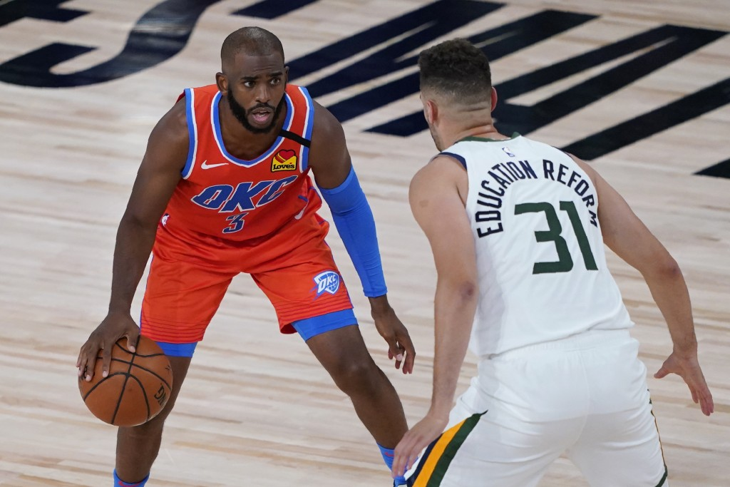 Utah Jazz's Georges Niang (31) guards Oklahoma City Thunder's Chris Paul (3) during the first half of an NBA basketball game Saturday, Aug. 1, 2020, i...