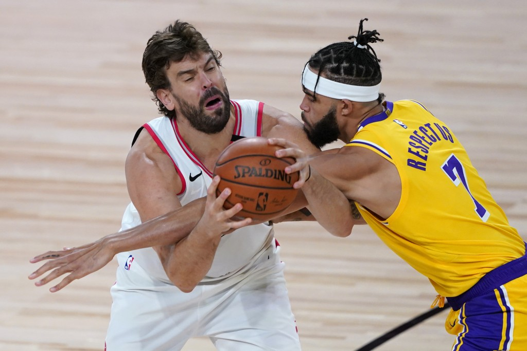 Los Angeles Lakers' JaVale McGee (7) guards Toronto Raptors' Marc Gasol during the second half of an NBA basketball game Saturday, Aug. 1, 2020, in La...