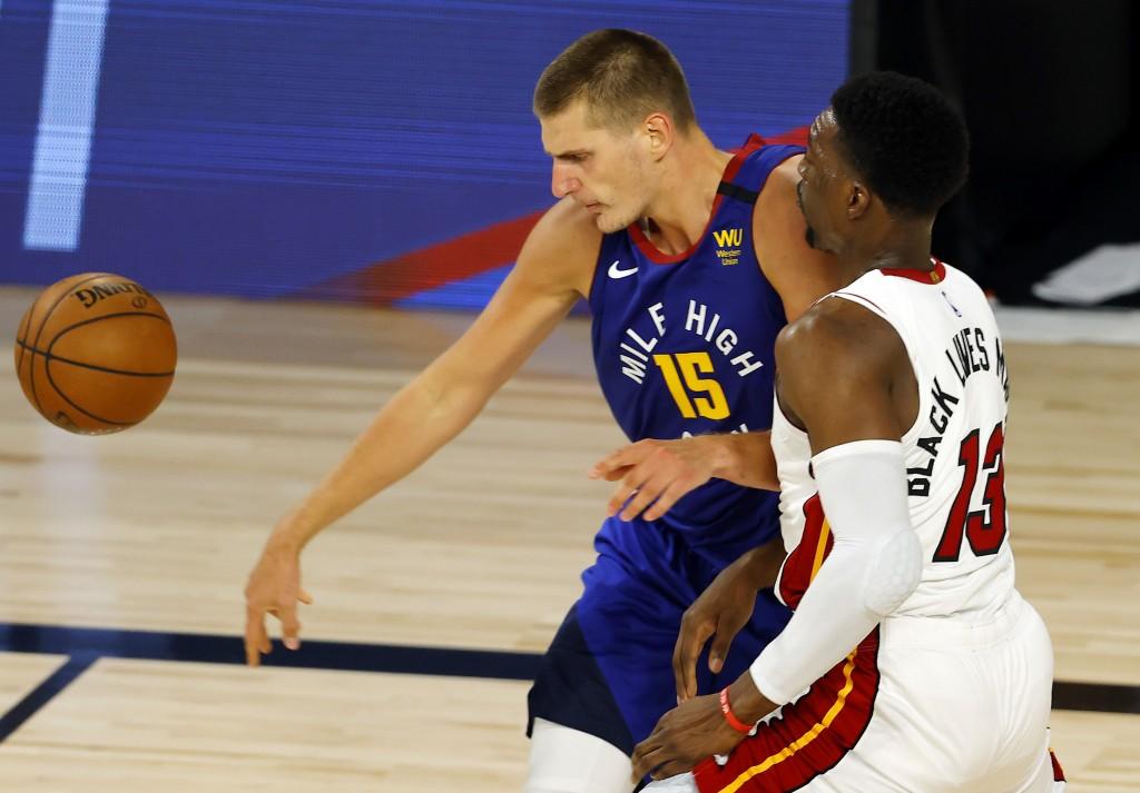 Denver Nuggets' Nikola Jokic loses control of the ball against Miami Heat's Bam Adebayo during an NBA basketball game, Saturday, Aug. 1, 2020, in Lake...