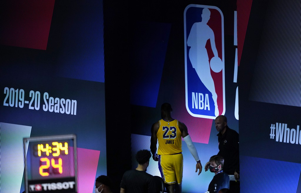 Los Angeles Lakers' LeBron James walks off the court during halftime of an NBA basketball game against the Toronto Raptors, Saturday, Aug. 1, 2020, in...