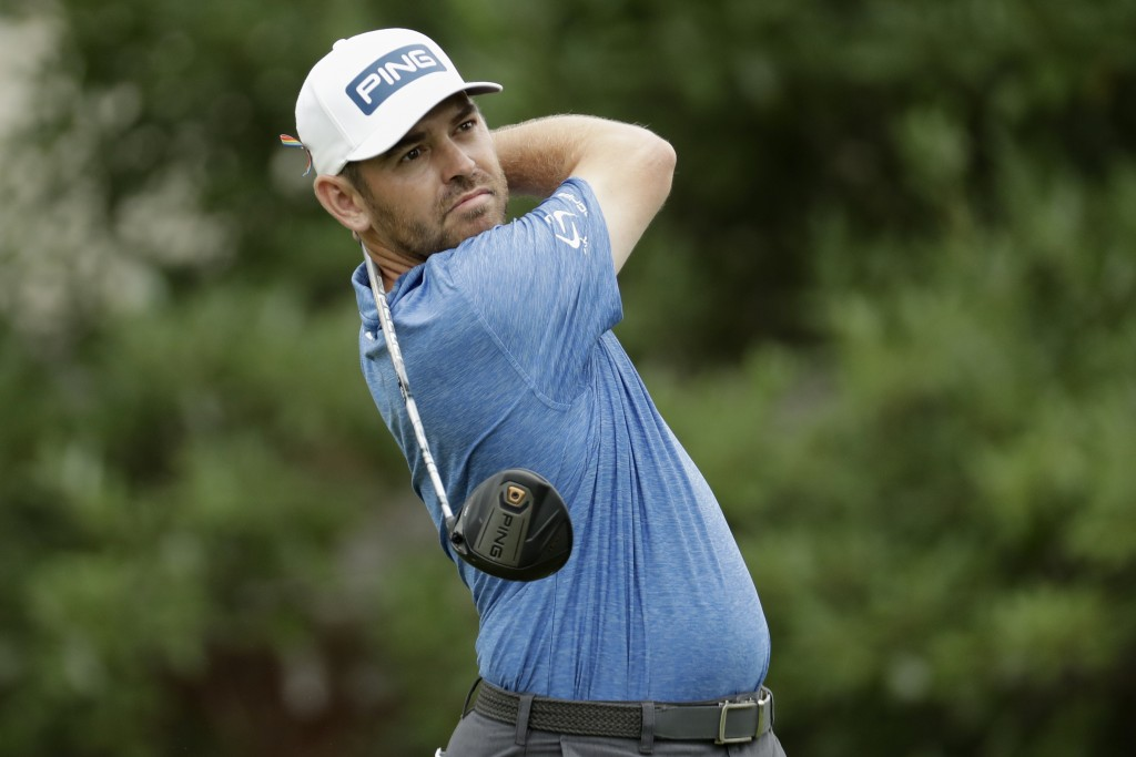 Louis Oosthuizen of South Africa, watches his tee shot on the 18th hole during the third round of the World Golf Championship-FedEx St. Jude Invitatio...