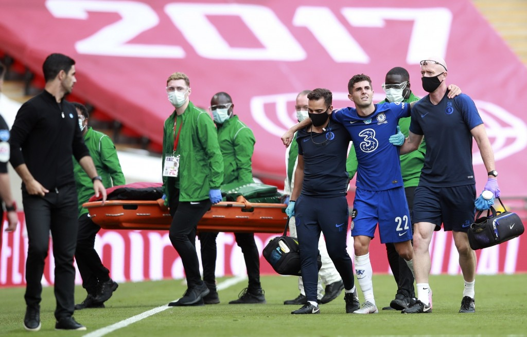 Chelsea's Christian Pulisic is assisted from the field after getting injured during the FA Cup final soccer match between Arsenal and Chelsea at Wembl...
