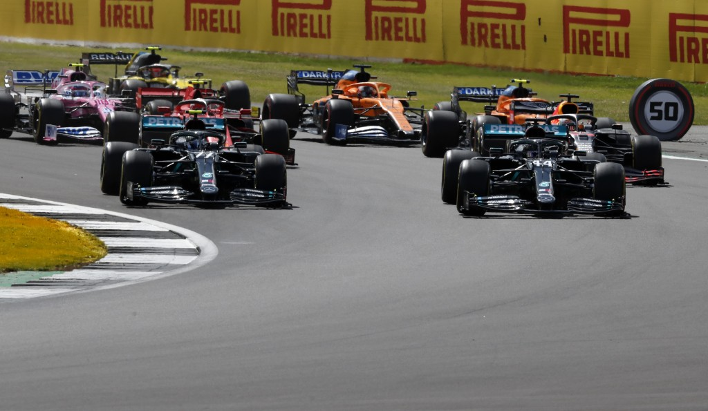 Mercedes driver Lewis Hamilton of Britain, front right, leads after the start of the British Formula One Grand Prix at the Silverstone racetrack, Silv...