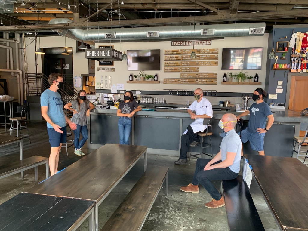 In a July 2020 photo provided by Wolf's Ridge Brewing, owner Bob Szuter, employees Allison Randolph and Alicia Herrmann, sous chef Andy Zamagias, gene...