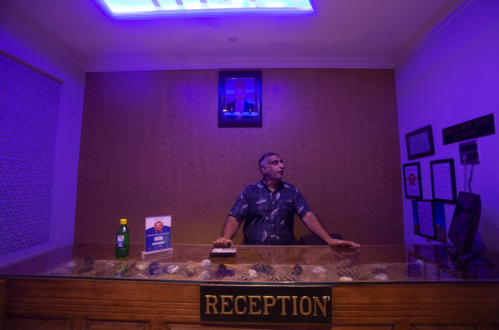 Kashmiri hotel manager Khurshid Ahmed stands at the reception counter of Hotel Standard during lockdown to stop the spread of the coronavirus in Srina...