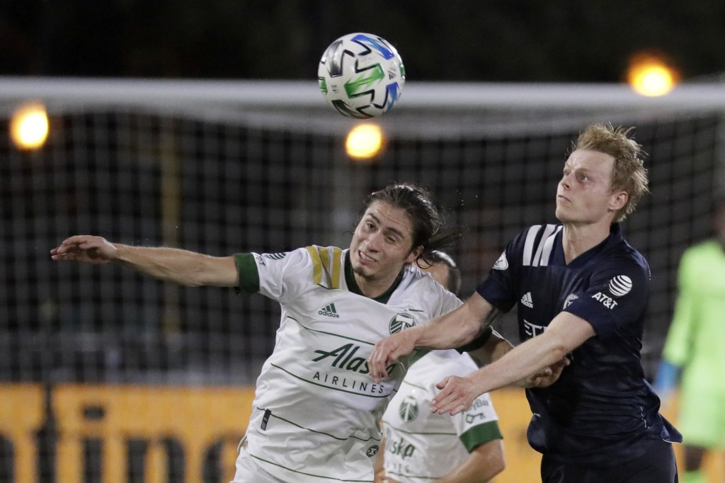 Portland Timbers defender Jorge Villafana, left, and New York City midfielder Gary Mackay-Steven battle for the ball during the second half of an MLS ...