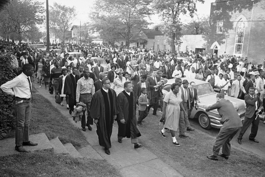 FILE - In this April 14, 1963 file photo, two ministers lead protest marchers in a civil rights demonstration in Birmingham, Ala., which was later bro...