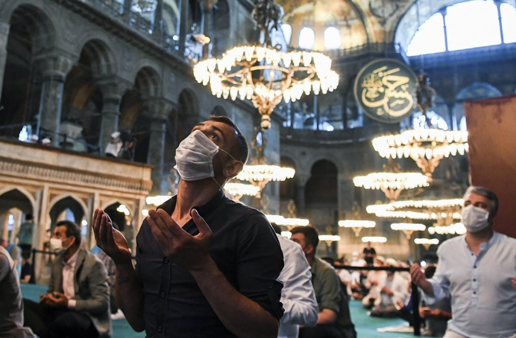 Muslims, wearing protective masks as a precaution against infection from coronavirus, gather for the Eid al-Adha prayer inside the Byzantine-era Hagia...