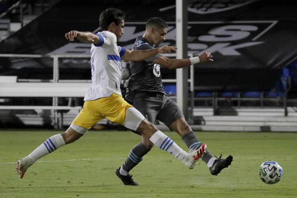 Minnesota United forward Luis Amarilla, right, scores past San Jose Earthquakes defender Oswaldo Alanis during the second half of an MLS soccer match,...