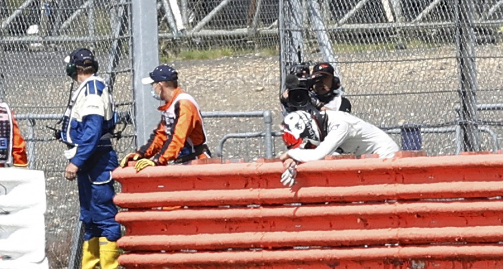 Alpha Tauri driver Daniil Kvyat of Russia leans on the guard rail after crashing during the British Formula One Grand Prix at the Silverstone racetrac...