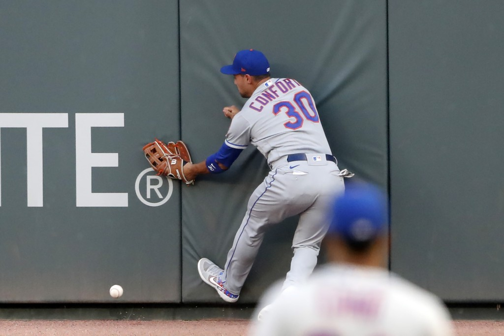 New York Mets right fielder Michael Conforto can't get to a ball hits for an RBI double by Atlanta Braves' Tyler Flowers during the second inning of a...