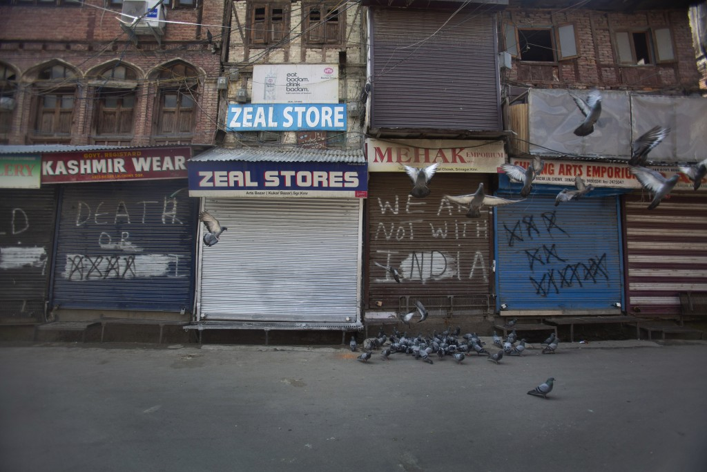 Pigeons fly at a deserted market area during lockdown to stop the spread of the coronavirus in Srinagar, Indian controlled Kashmir,  July 22, 2020. In...