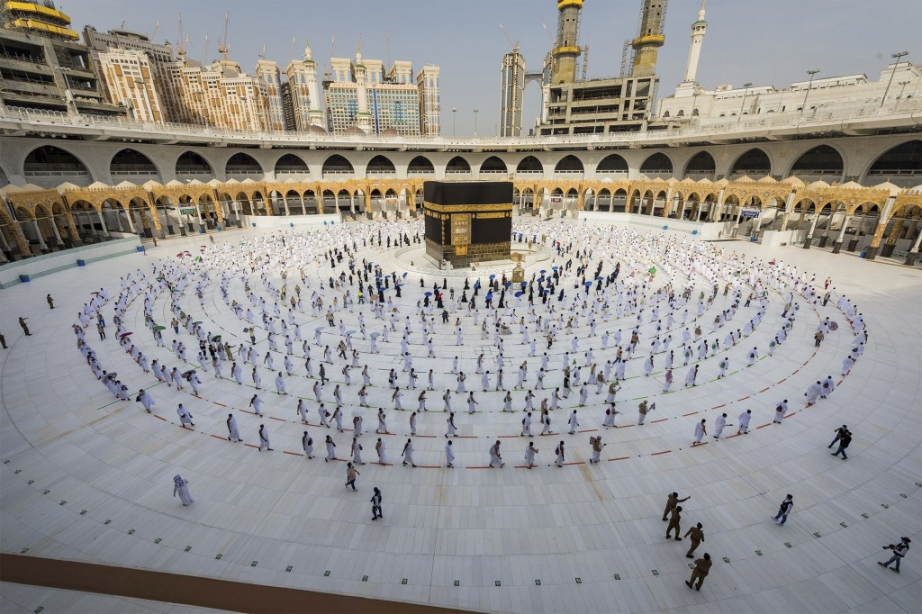 Pilgrims walk around the Kabba at the Grand Mosque, in the Muslim holy city of Mecca, Saudi Arabia, Friday, July 31, 2020. The global coronavirus pand...