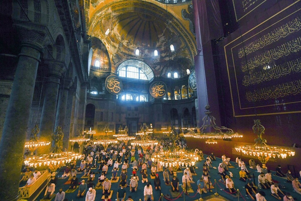 Muslims, wearing protective masks as a precaution against infection from coronavirus gather for the Eid al-Adha prayer inside the Byzantine-era Hagia ...