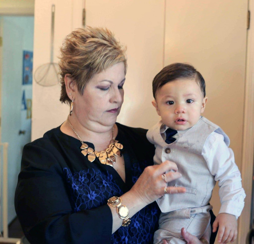 In this May 23, 2020  photo provided by Tito Anchondo, Paul Anchondo is held by his grandmother, Brenda Anchondo in El Paso, Texas. The toddler is unl...