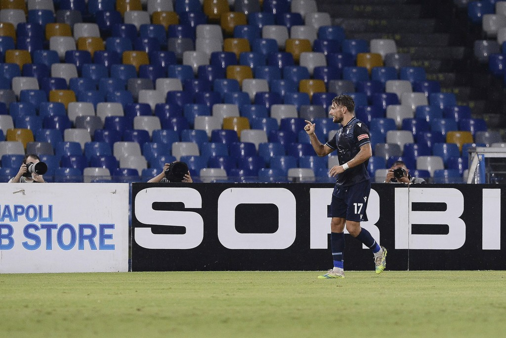 Lazio's Ciro Immobile celebrates after scoring a goal during a Serie A soccer match between Napoli and Lazio, at the San Paolo stadium in Naples, Ital...