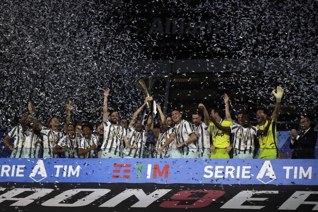 Juventus' Giorgio Chiellini and Juventus' Leonardo Bonucci hold up the trophy as Juventus players celebrate winning an unprecedented ninth consecutive...